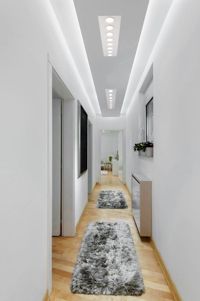 LED_lighting_benefits_long_lighted_hallway_fancy