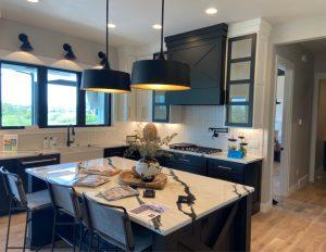 High_end_stylish_kitchen_with_pendant_lights_appliances_sconces